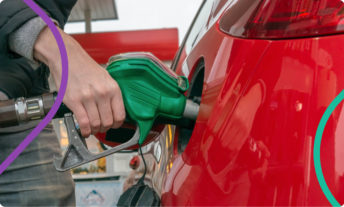person filling up gas tank