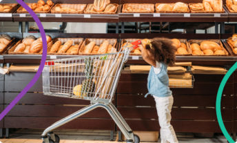 young child pushing a shopping cart