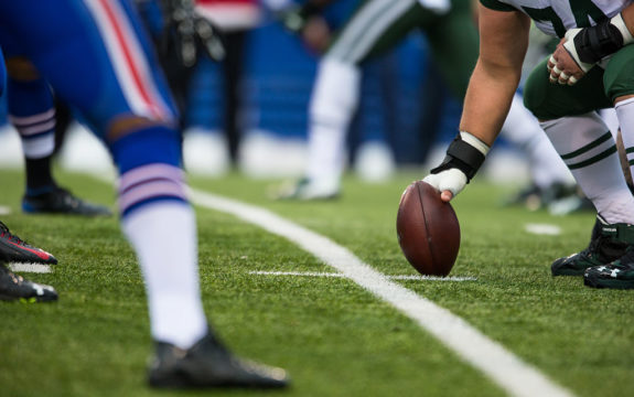 Football player snapping the ball