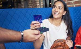 Woman making a contactless payment